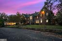 Front exterior at twilight with wing - 40568 HIDDEN HILLS LN, PAEONIAN SPRINGS