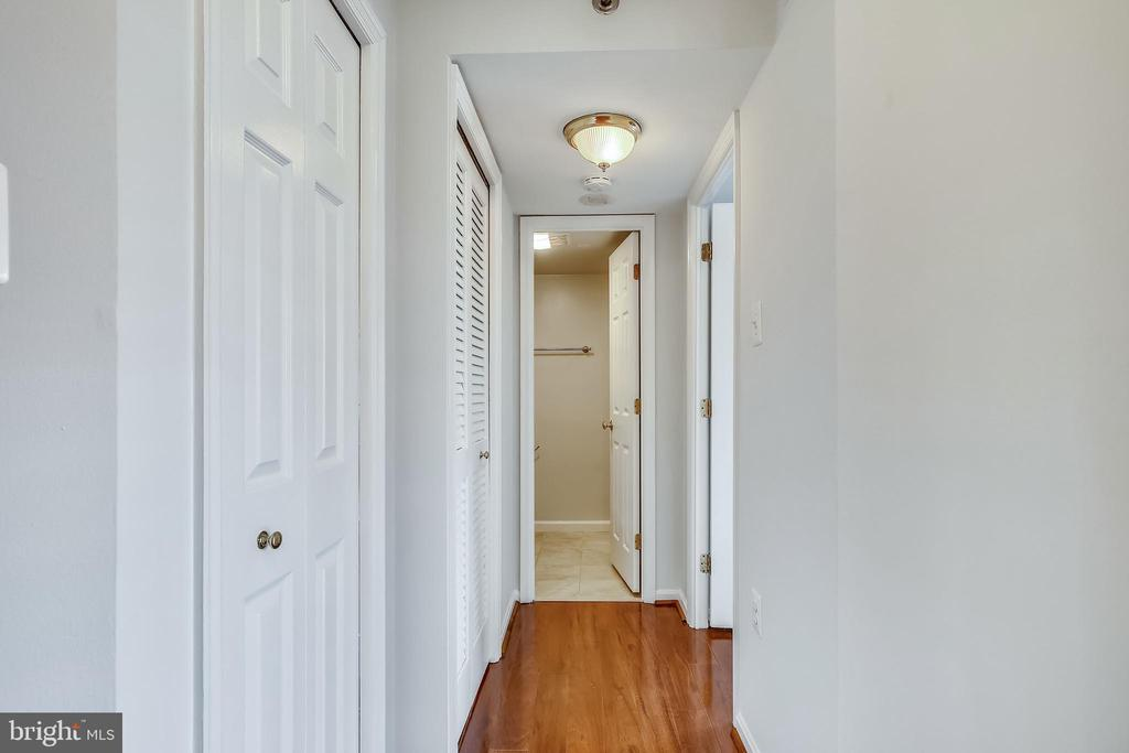 Closet and stackable washer/ dryer in hall - 1301 N COURTHOUSE #1607, ARLINGTON