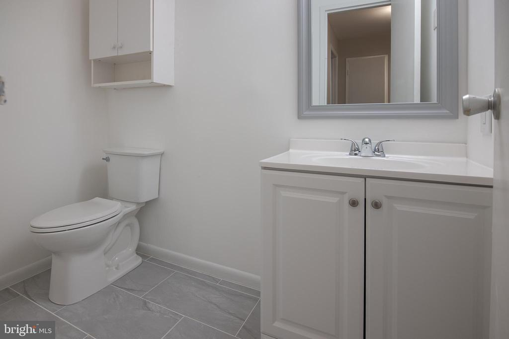 Lower level powder room - 11580 WOODHOLLOW CT, RESTON