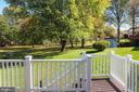 Deck overlooks backyard and common area - 207 ORCHARD CIR, HAMILTON