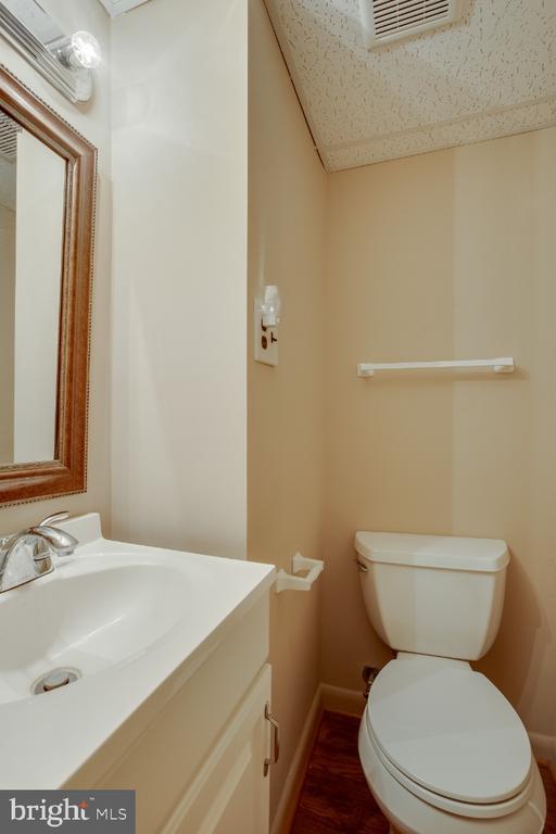 Lower level half bathroom - 161 LAWSON RD SE, LEESBURG