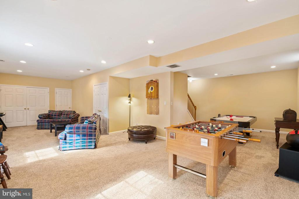 Generous Game Room Area to Recreation Room View - 7893 MEADOWGATE DR, MANASSAS