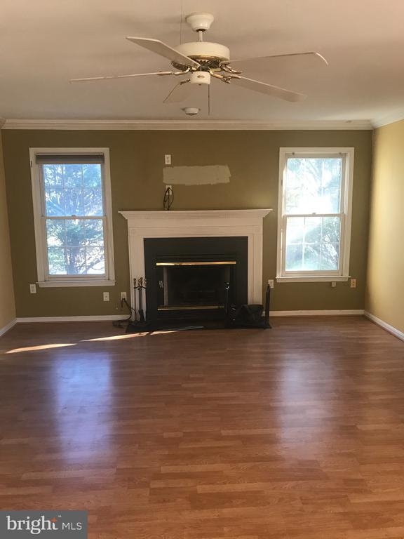 Family room with hard wood floor & fire place - 1118 SUGAR MAPLE LN, HERNDON