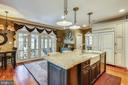 Gourmet Kitchen is open to Screened Porch - 4808 WHISKEY CT, IJAMSVILLE