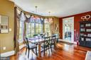 Dining Rm with Cherry Floors and walls of windows - 4808 WHISKEY CT, IJAMSVILLE