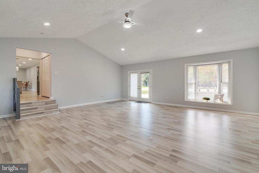Rec Room w/vaulted ceiling, new paint and flooring - 89 CLEREMONT DR, FREDERICKSBURG