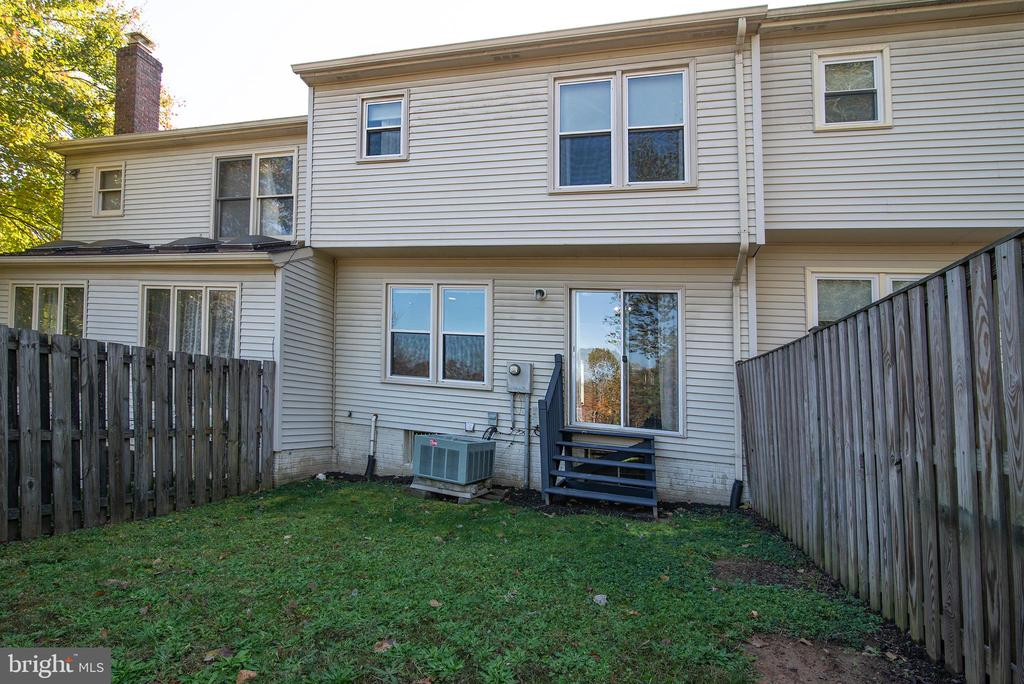 Grassed back yard.  Plenty of space for patio. - 102 TWIN BROOK LN, STAFFORD
