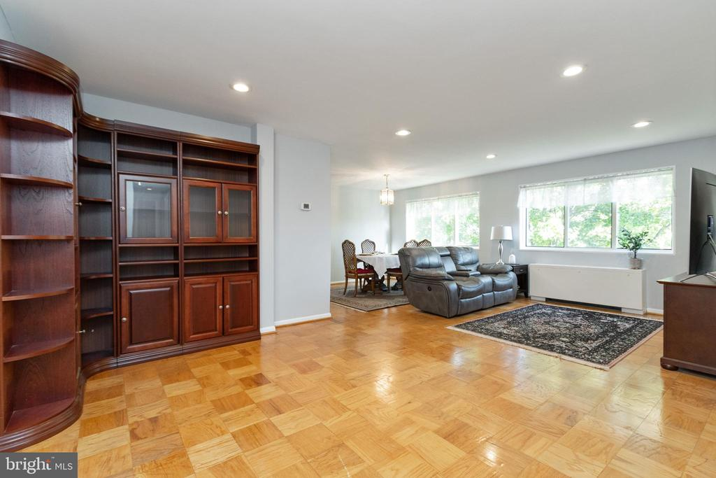 Inviting sun filled living and dining room. - 200 N MAPLE AVE #607, FALLS CHURCH