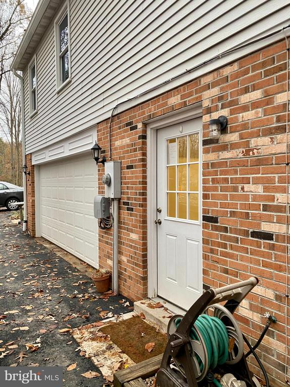 Door Opens to Mud Room & Laundry - 11798 TARGET CT, WOODBRIDGE