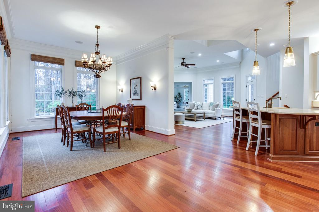 Gleaming Santos Mahogany flooring - 10464 SPRINGVALE MEADOW LN, GREAT FALLS