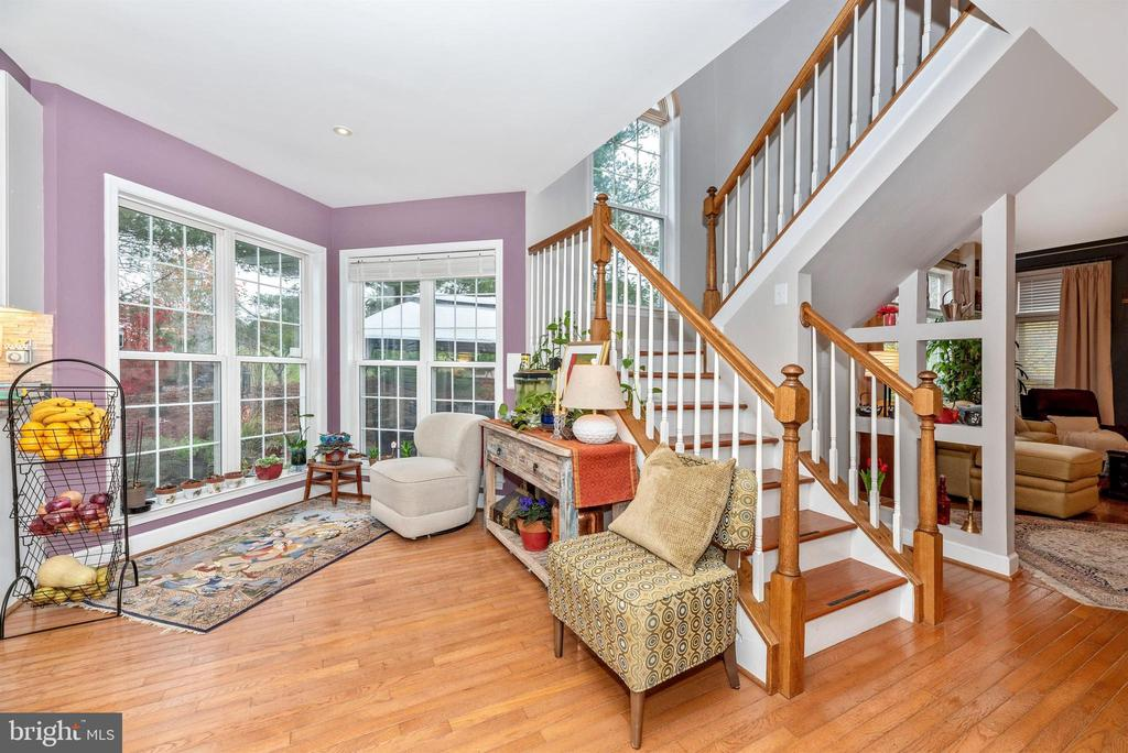 Sun-filled breakfast room. Rear staircase. - 6287 IVERSON TER S, FREDERICK