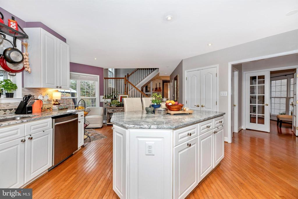 Kitchen with gorgeous counters and center island. - 6287 IVERSON TER S, FREDERICK