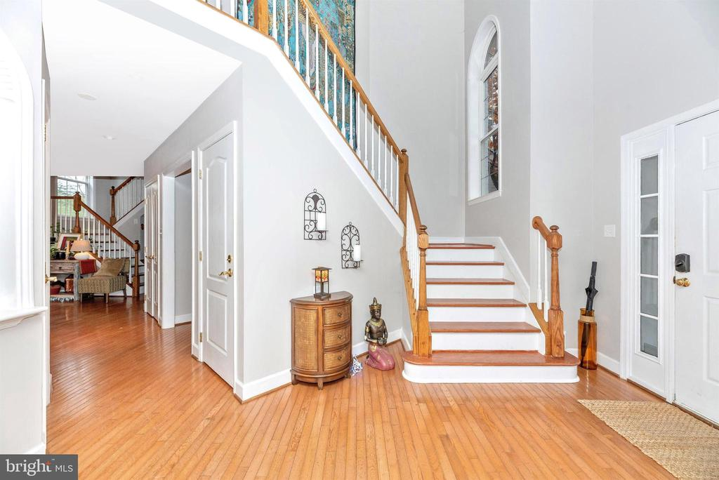 Main entrance foyer - home offers dual staircases. - 6287 IVERSON TER S, FREDERICK