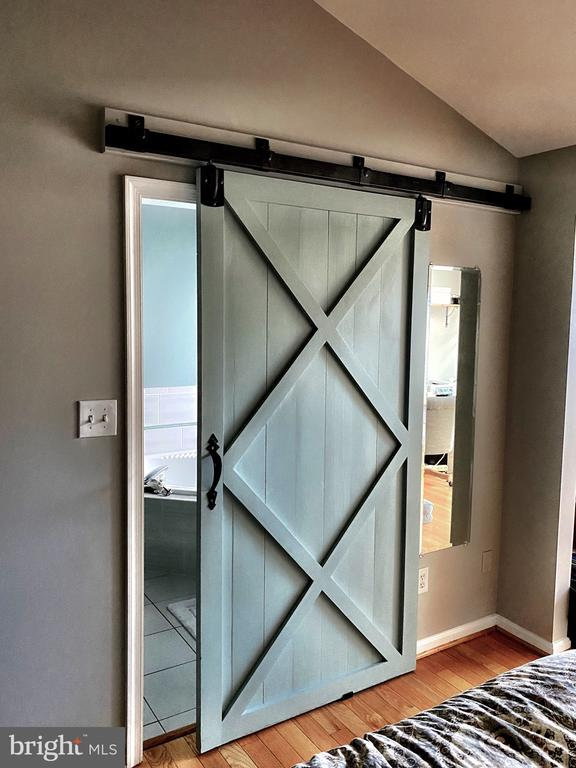 Custom sliding barn door to master bathroom suite - 43669 SCARLET SQ, CHANTILLY