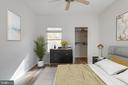 Second bedroom (virtually staged) - 14316 CLIMBING ROSE WAY #203, CENTREVILLE