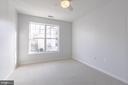 Bedroom illuminated by natural light! - 11326 ARISTOTLE DR #4-303, FAIRFAX