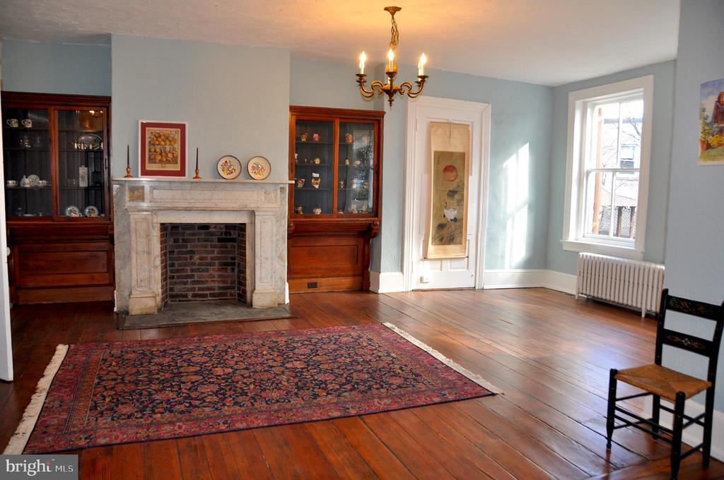Entry parlor, original built-ins, marble fireplace - 4343 39TH ST NW, WASHINGTON