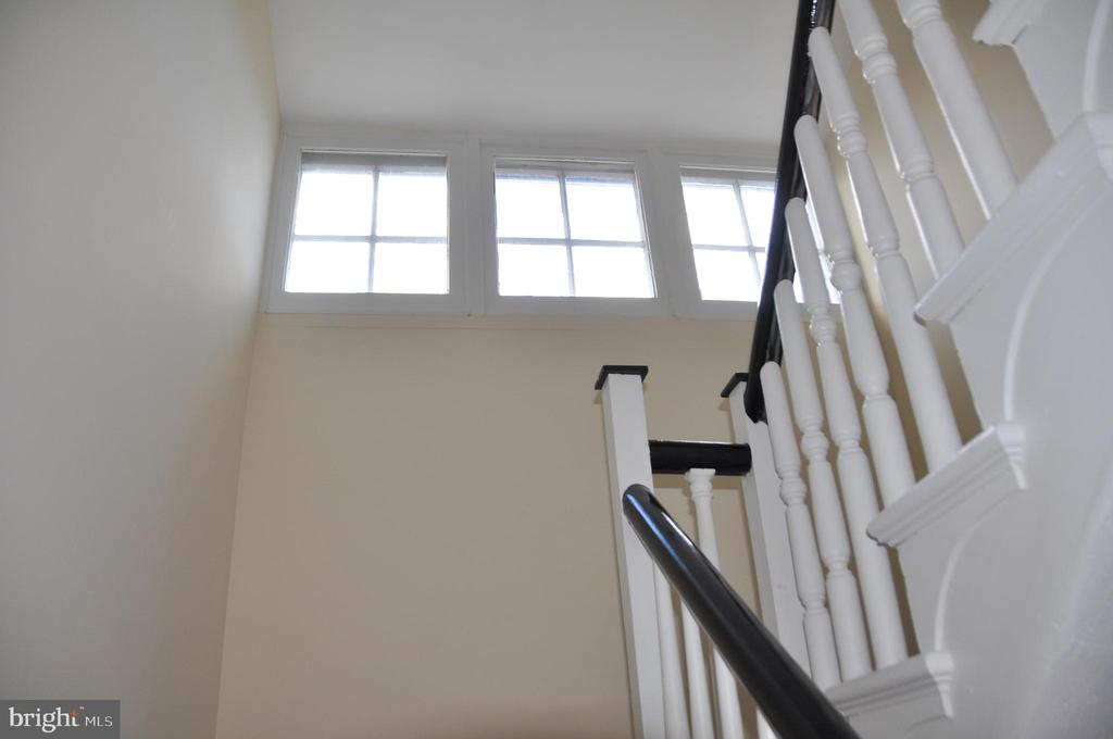 Stairway turns toward third floor - 4343 39TH ST NW, WASHINGTON