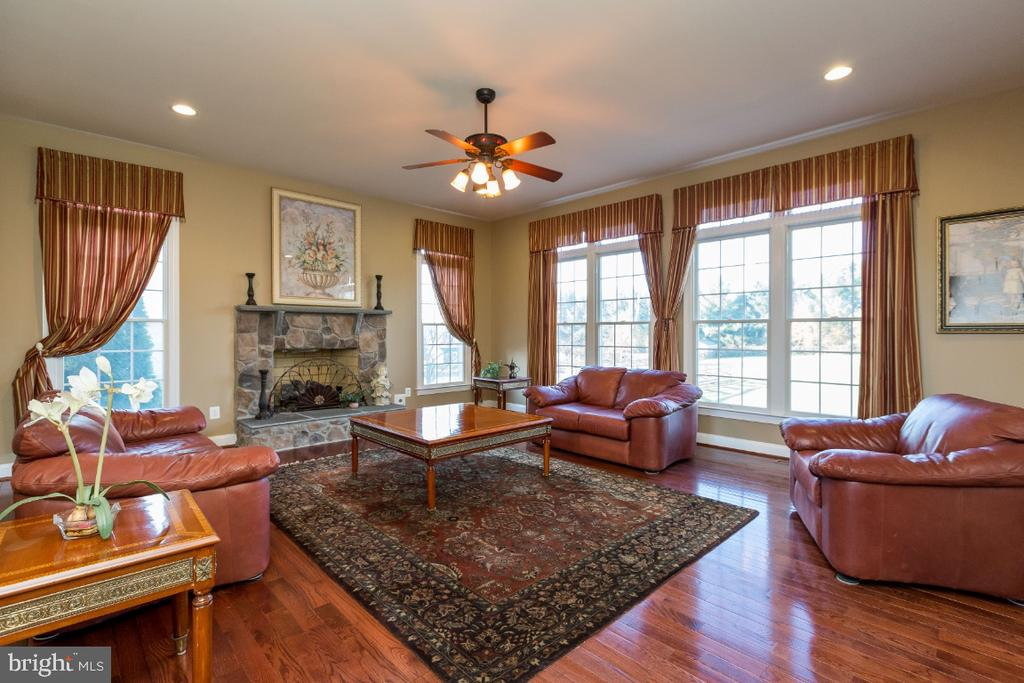 Family Room with Stone Fireplace - 40732 CHEVINGTON LN, LEESBURG
