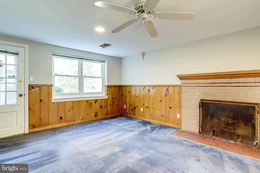 wood burning fireplace in the lower level bedroom - 3412 ALABAMA AVE, ALEXANDRIA