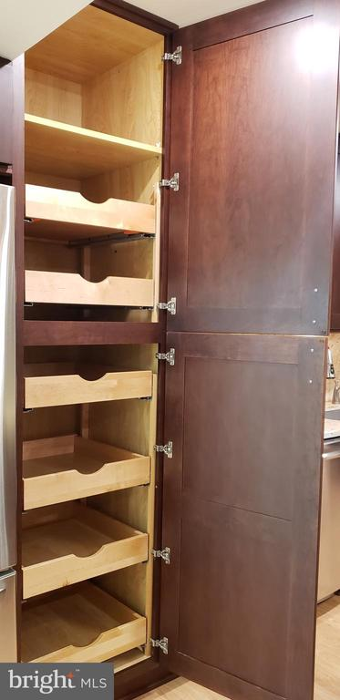 Eight Ft kitchen cabinet with pullout drawers - 11503 MAPLE RIDGE RD, RESTON