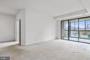 Spacious living area opens up to sunroom - 19355 CYPRESS RIDGE TER #405, LEESBURG