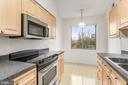 Bright and Light eat-in kitchen - 19355 CYPRESS RIDGE TER #405, LEESBURG