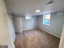 Basement's 1st bedroom. - 6021 AMHERST AVE, SPRINGFIELD