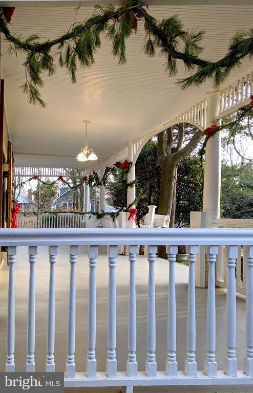 Side porch decorated for the holidays - 4343 39TH ST NW, WASHINGTON
