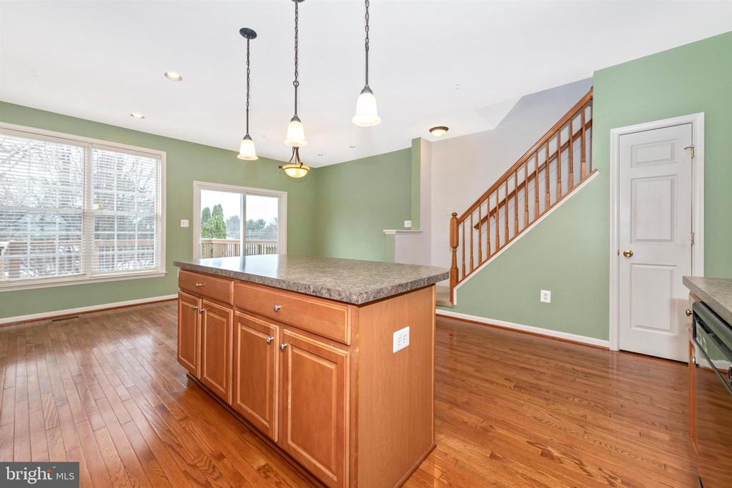 KITCHEN VIEW WITH ISLAND AND BACK STAIR CASE - 311 GREEN FERN CIR, BOONSBORO