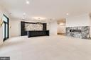 A dramatic wet bar anchors the games room - 620 RIVERCREST DR, MCLEAN