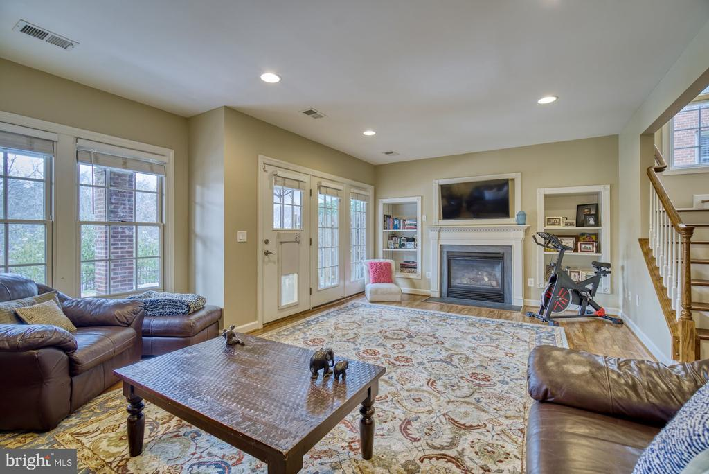Lower Level Family Room with Gas Fireplace - 18541 BEAR CREEK TER, LEESBURG