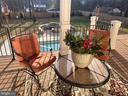Main level Deck overlooking stunning pool area - 10713 ROSEHAVEN ST, FAIRFAX
