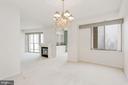 open floor plan dining room into family room - 19365 CYPRESS RIDGE TER #703, LEESBURG