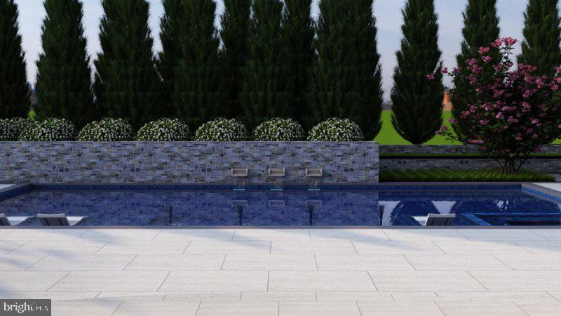 Stone walls and water features enhance the pool - 1011 TURKEY RUN RD, MCLEAN