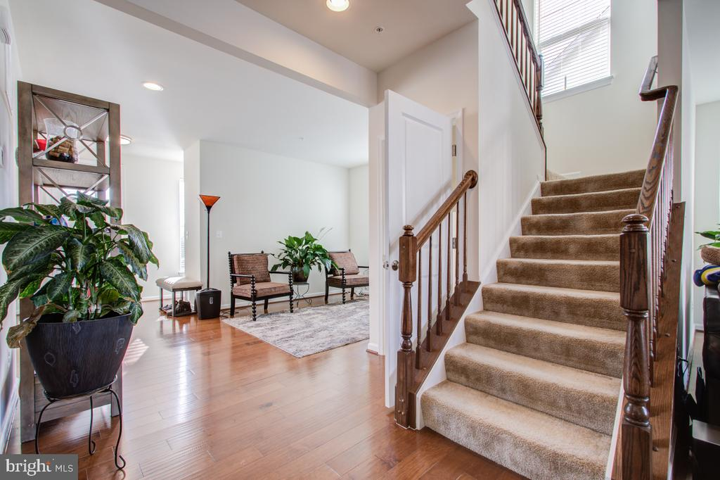 Stairs to the upper level, high ceilings. - 5502 HAWK RIDGE RD, FREDERICK