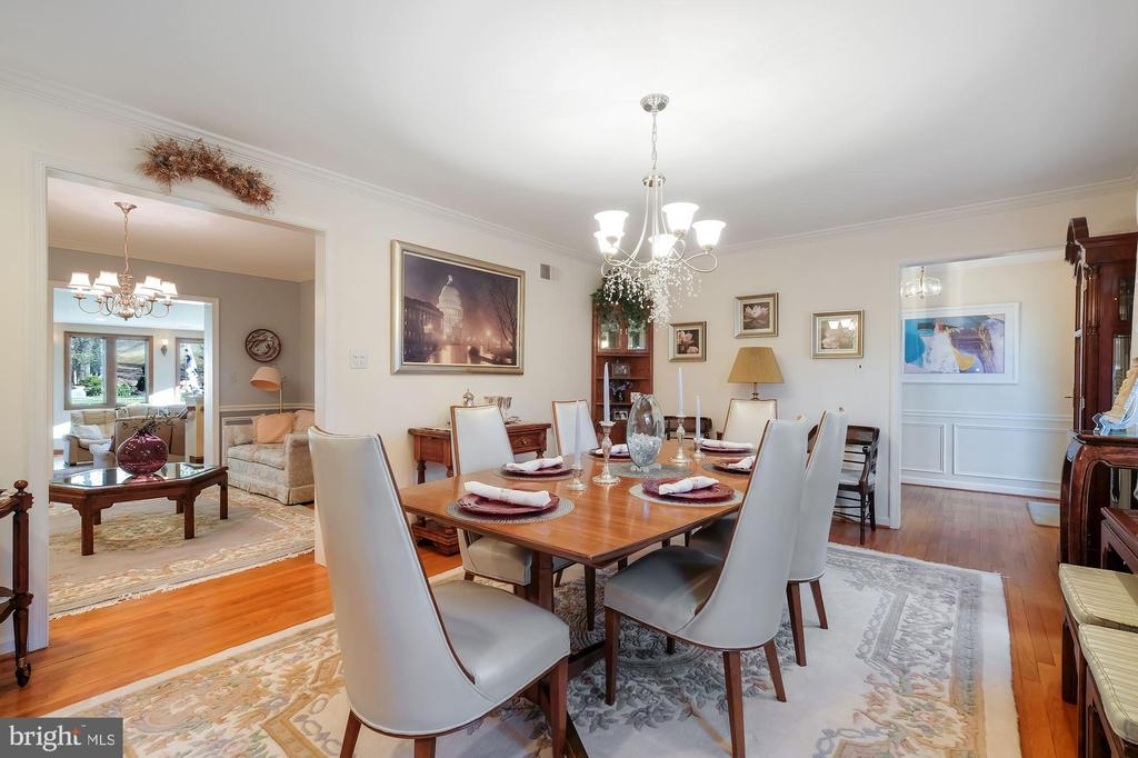 Dining room with gas fireplace #1 - 5707 ROSSMORE DR, BETHESDA