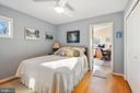 3rd bedroom with hardwood floors - 5707 ROSSMORE DR, BETHESDA