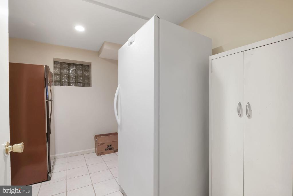 Lower level finished storage area with 2nd laundry - 5707 ROSSMORE DR, BETHESDA