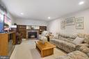 Lower level den with gas fireplace #4 - 5707 ROSSMORE DR, BETHESDA