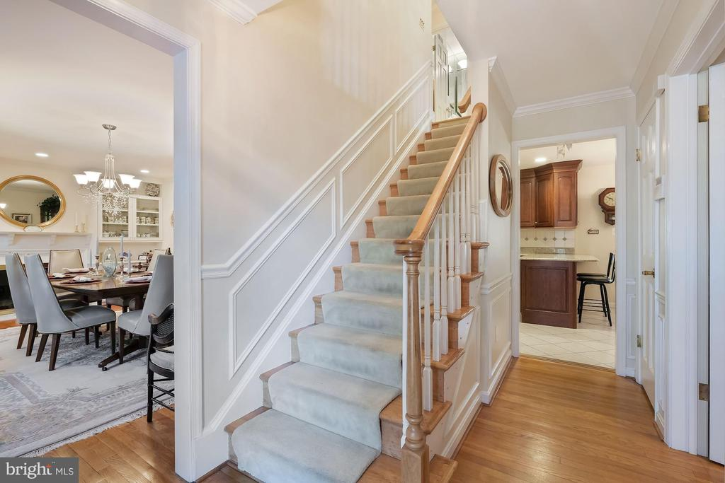 Entryway with hardwood floors - 5707 ROSSMORE DR, BETHESDA
