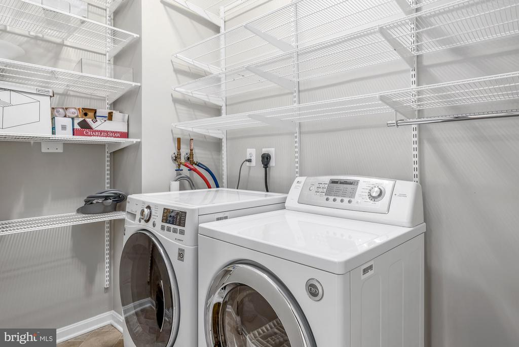 Laundry room with great storage - 19360 MAGNOLIA GROVE SQ #212, LEESBURG