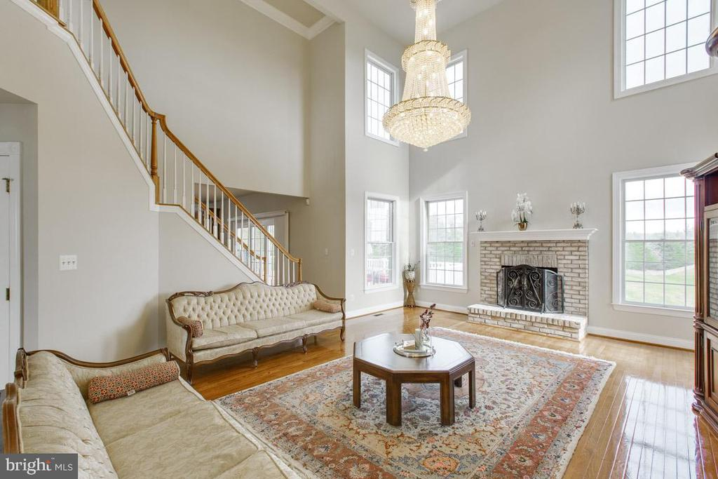 Spacious family room with wood burning fireplace - 41205 CANONGATE DR, LEESBURG