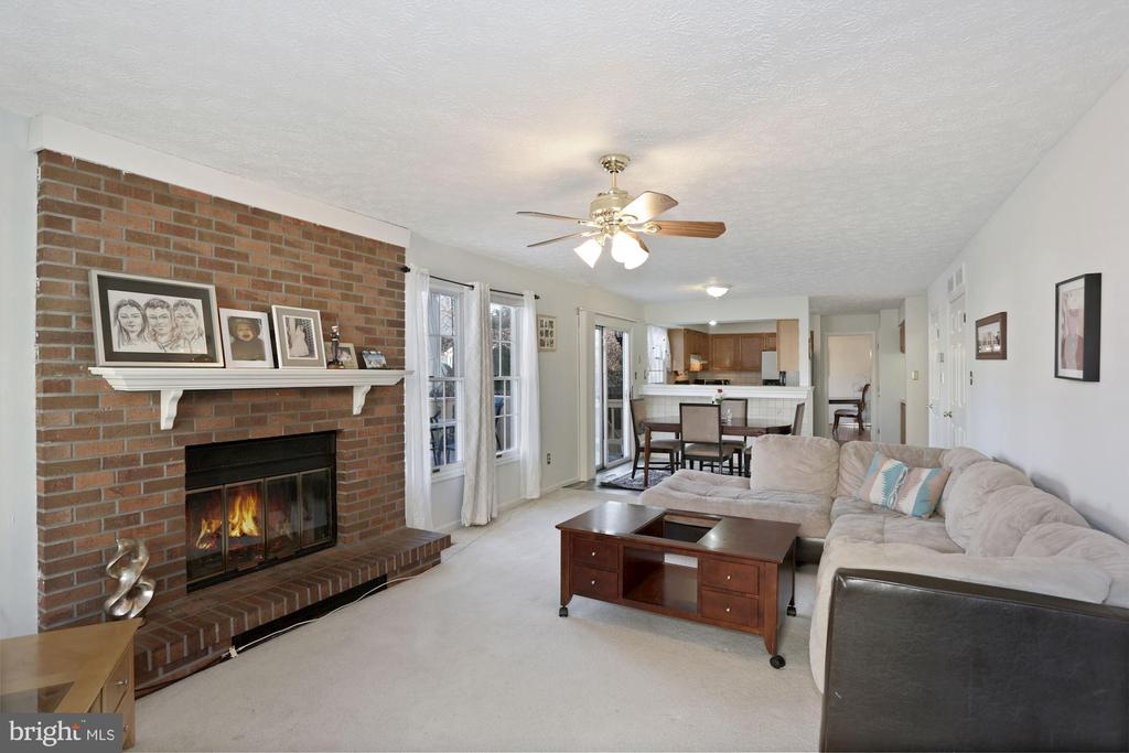 brick cozy fireplace - 21108 MIDDAY LN, STERLING
