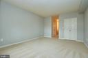 Primary bedroom with three closets - 19350 MAGNOLIA GROVE SQ #407, LEESBURG