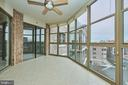 Sunroom overlooks the rooftop tennis courts - 19350 MAGNOLIA GROVE SQ #407, LEESBURG