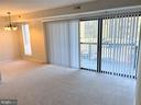 Living Room with Sliding Glass Doors to Balcony - 11053 CAMFIELD CT #101, MANASSAS