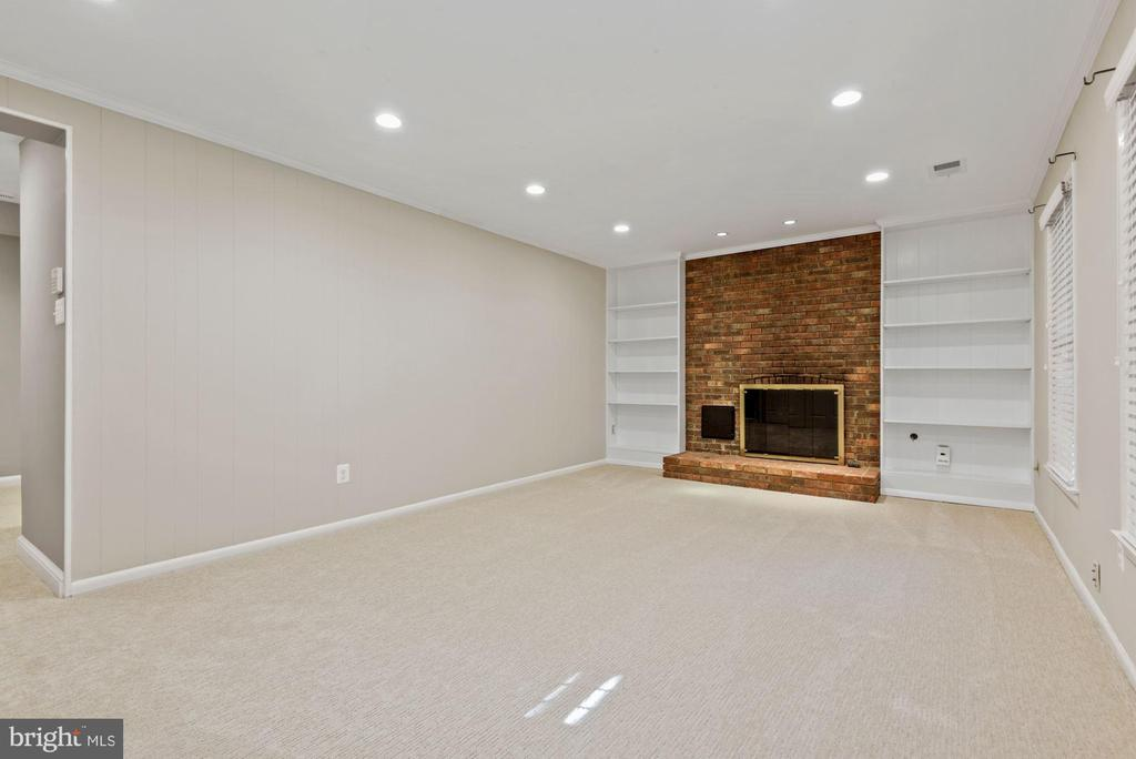 Fireplace surrounded by custom built-ins - 3145 14TH ST S, ARLINGTON