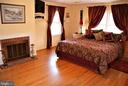 Primary bedroom with fireplace - 12138 HARPERS FERRY RD, PURCELLVILLE
