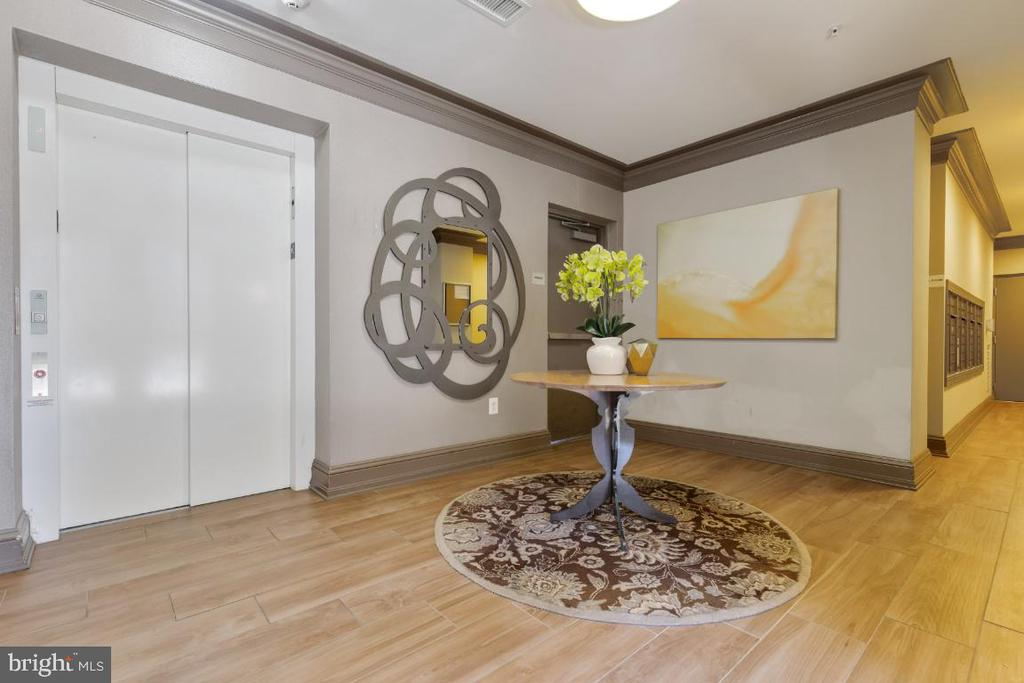 Main lobby with mail room - 3160 JOHN GLENN ST #308, HERNDON